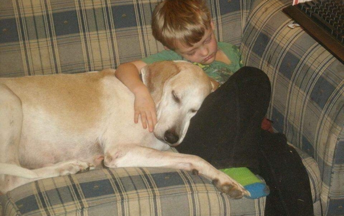sleeping child with his hound